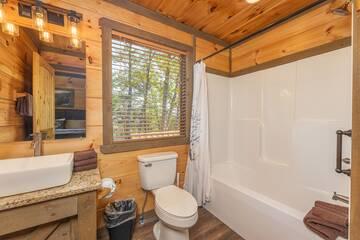 Upstairs bedroom full bath with farm wash basin.