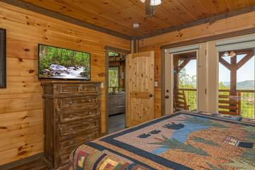 Enjoy  Smoky Mountain views and television from your master bedroom.