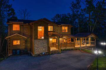 Dusk settles over your large Pigeon Forge cabin in the Tennessee Smoky Mountains.
