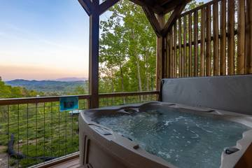 Large hot tub with scenic views of the Smoky Mountains.