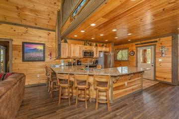 Smokies rental cabin with breakfast bar seating and more.