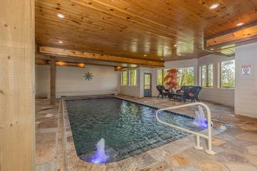 Cabin's swimming pool has unique water spouts.