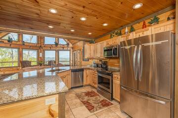 Fully equipped rental cabin kitchen with stainless steel appliances and lots of counter space.