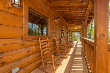 Your rental cabin has plenty of rockers for relaxing in the shade.