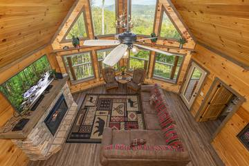 View of the rental cabin's living room from the loft.