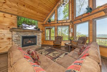 The Appalachian, a Pigeon Forge rental cabin with fireplace and large wall of windows.