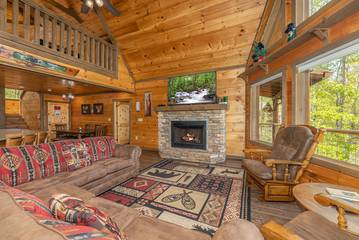 Enjoy the open Smoky Mountain cabin feel from this spacious seating area.