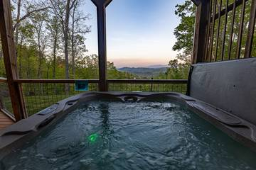 Watch the sunset from your rental cabin's hot tub.
