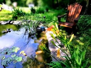 Sit alongside the peaceful cement pond.