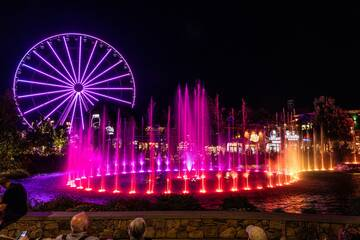 The Pigeon Forge Island water show at night.