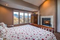 Spacious bedroom with a warm romantic wood fireplace