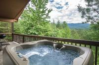 Relax in the hot tub and enjoy the beautiful Smoky Mountain scenery